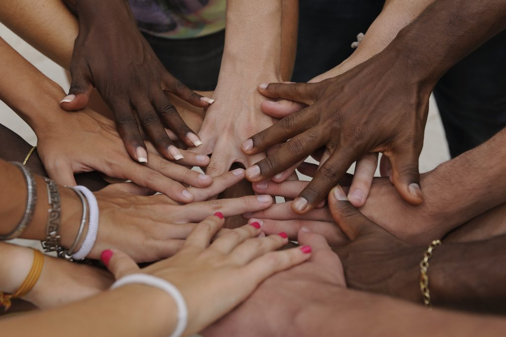 People's hands displaying different races